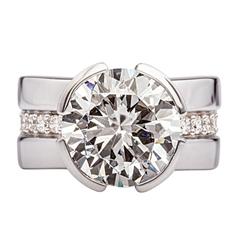 Picture of 07633: Sterling Silver Ring with Glittering White Cubic Zirconias and Segmented Rub Over Setting